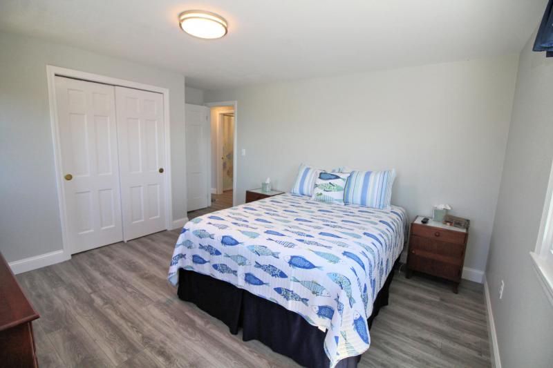 First floor bedroom with queen and bay view