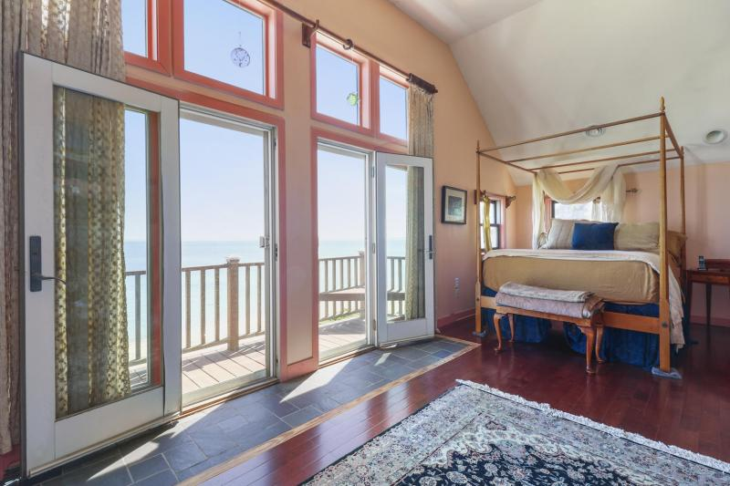 Master Bedroom with Queen bed and Balcony with Bay view