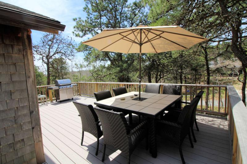 Large deck with outdoor furniture and grill