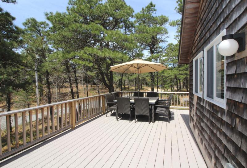 Large deck with table and gas grill