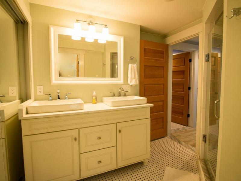 Bathroom with double sink and shower
