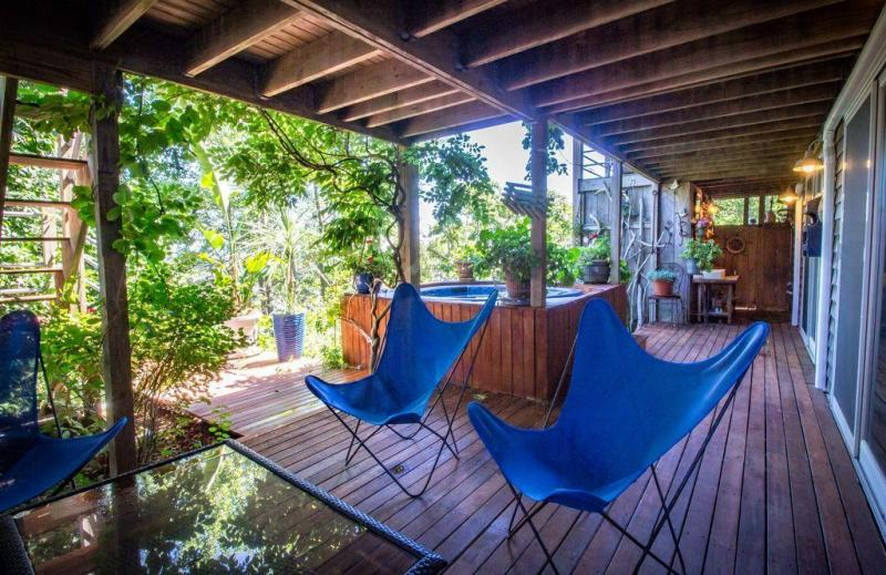 Lower deck with outdoor shower and hot tub