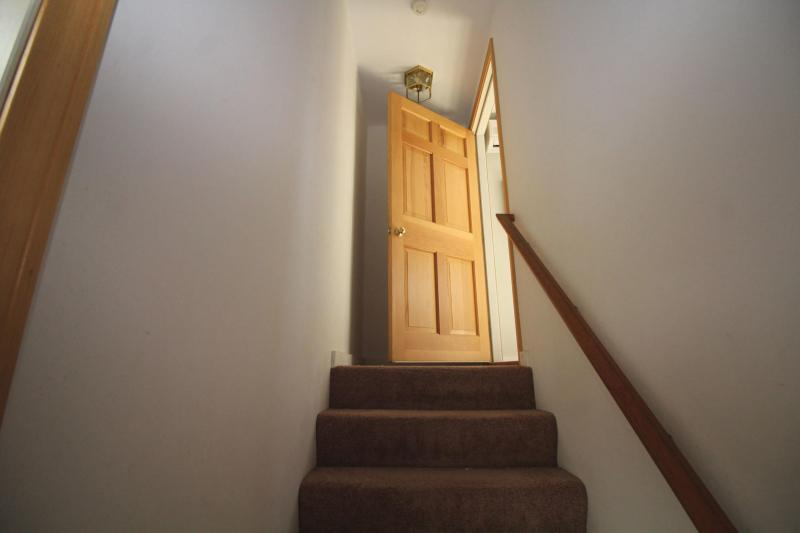 Staircase leads to separate second floor bedroom
