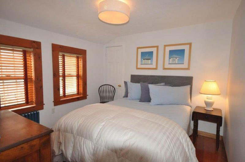 Bedroom with queen bed and AC
