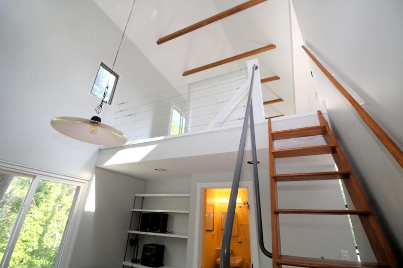Stairs lead to open sleeping loft