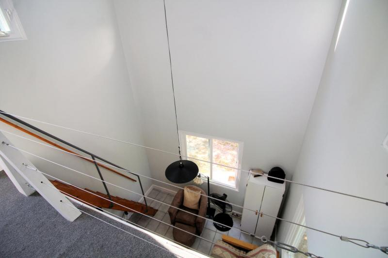 Looking down to living room from loft
