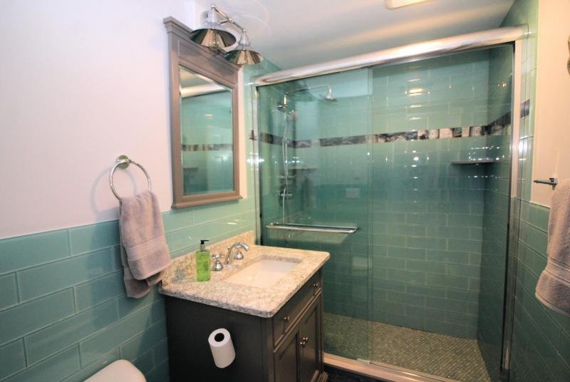 Beautifully renovated bathroom with custom tiled shower