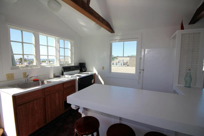 Well equipped kitchen overlooking deck and harbor