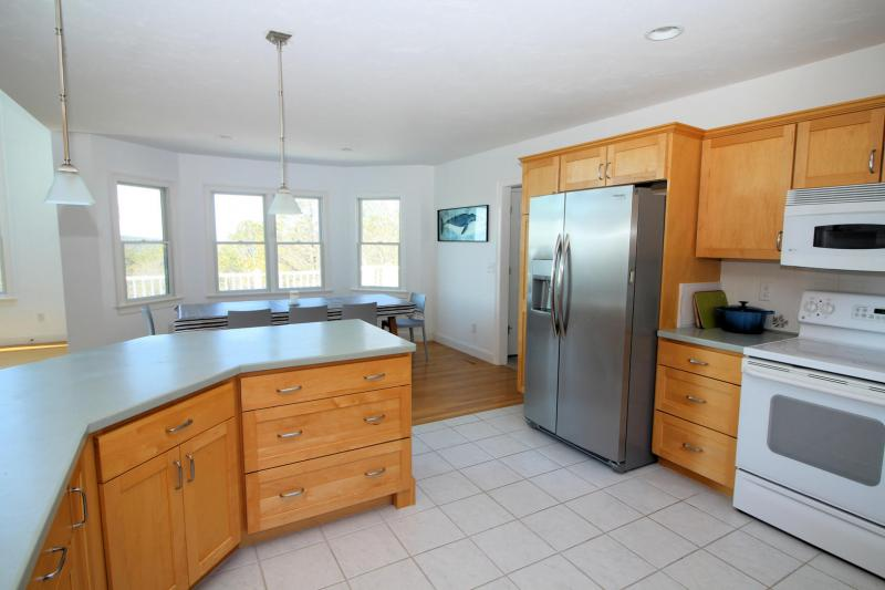 Kitchen has plenty of counter space and cabinets