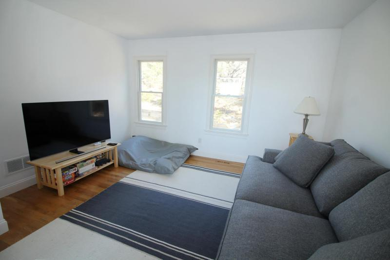 Den of living room with flat screen TV and sleeper sofa