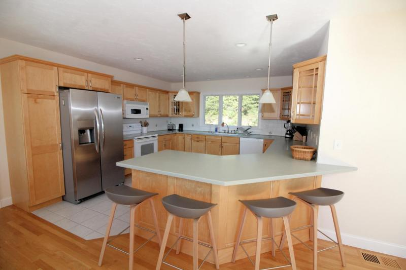 Open and bright kitchen with counter seating