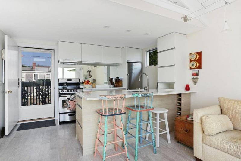 Kitchen with stainless appliances and counter seating