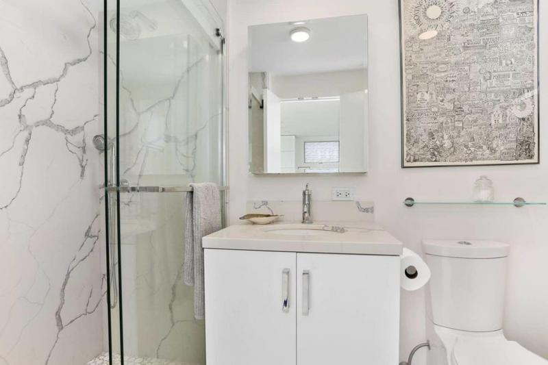 Full bathroom with shower with glass doors