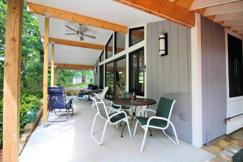 Lovely covered porch with outdoor furniture