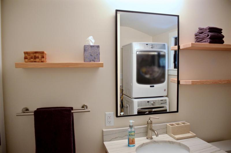 Washer and dryer conveniently located in master bathroom