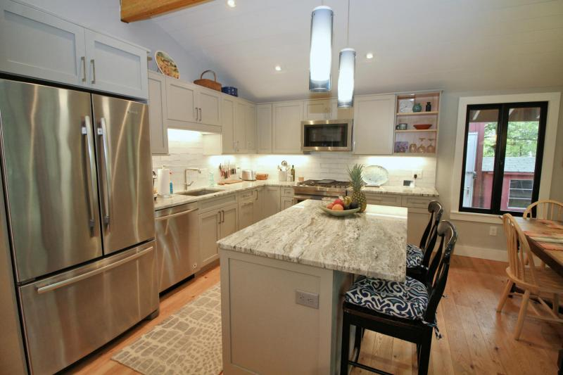 Fully equipped kitchen with marble counter tops