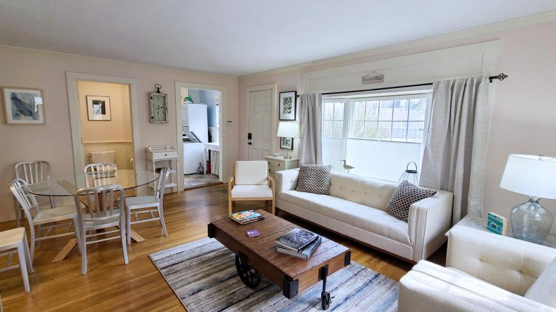 Living room has comfortable seating and a dining table with room