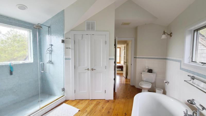 Second floor master bathroom with clawfoot tub and separate show