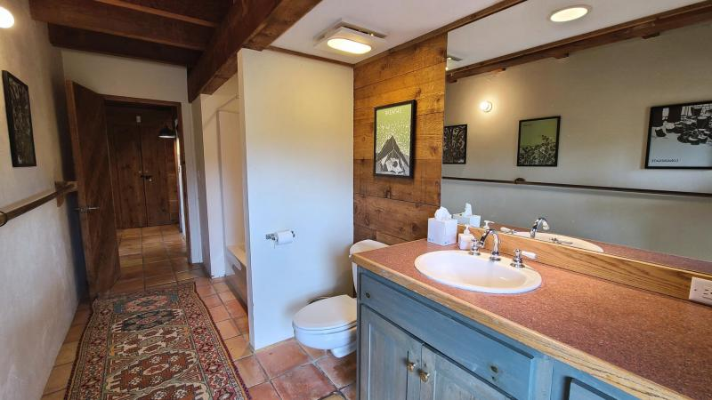 Lower level bathroom with tub and shower