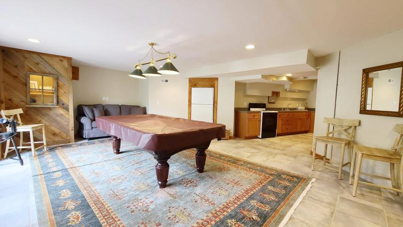 Rec room with pool table and pull out sofa