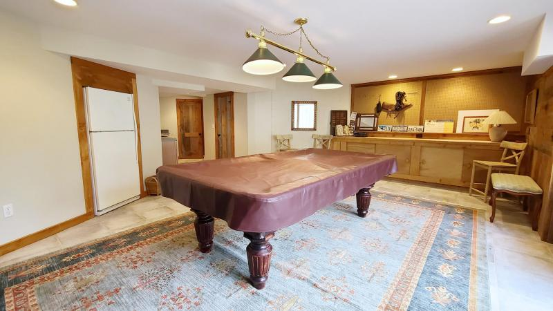Lower level rec room with pool table and kitchen