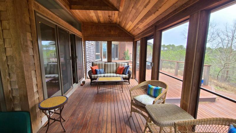 Plenty of seating on the screen porch