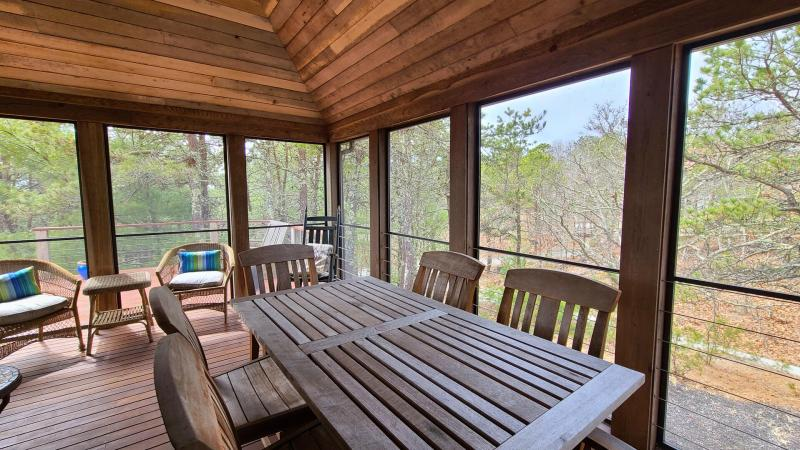Dining table on screen porch