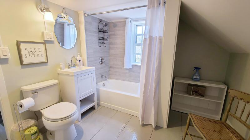 Second floor bathroom with combined tub and shower