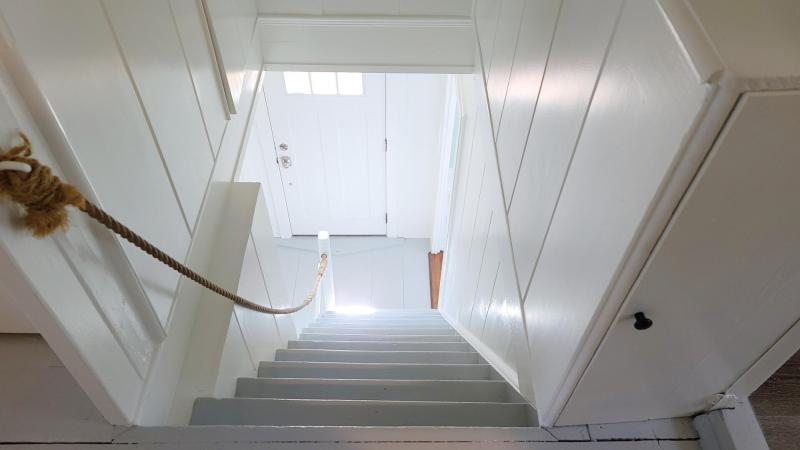Looking down the steps to the front hall below