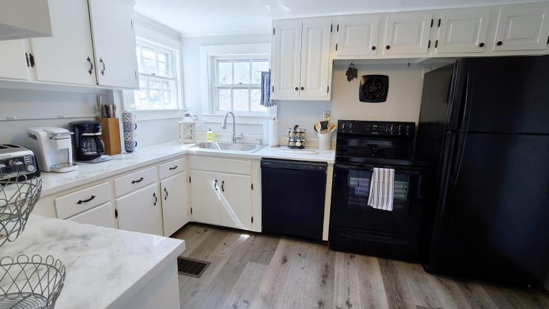 Nicely equipped kitchen with new appliances