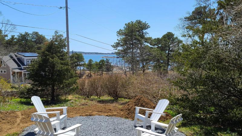 Fire pit looks out over Wellfleet Harbor