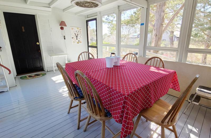Screen porch has a dining table