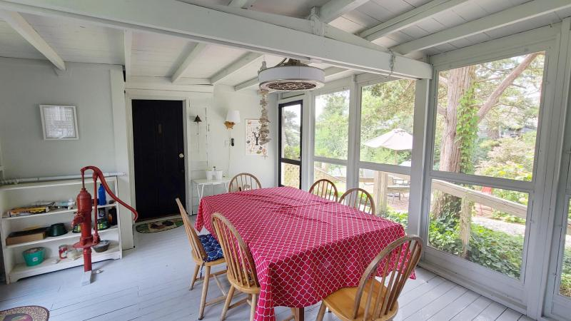 Screen porch with dining table