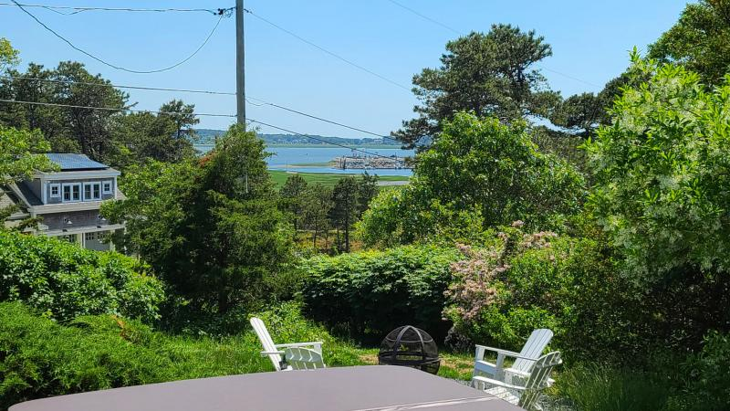 Hot tub with fire pit and Wellfleet Harbor views beyond