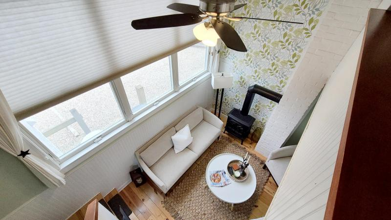 View of living room from bedroom above