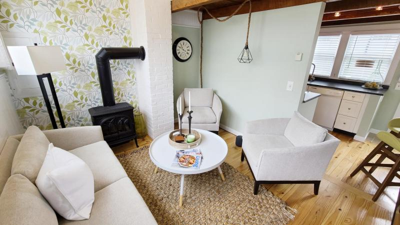 Living room has comfortable seating and TV