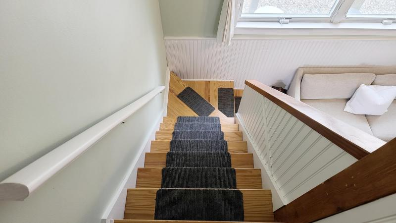 Steps from living room lead to bedroom