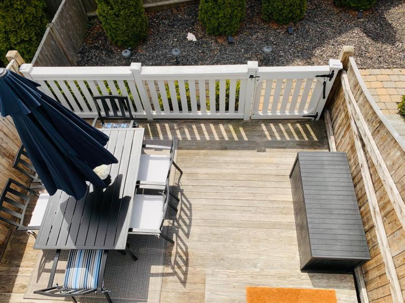 Exclusive use patio with outdoor furniture and gas grill