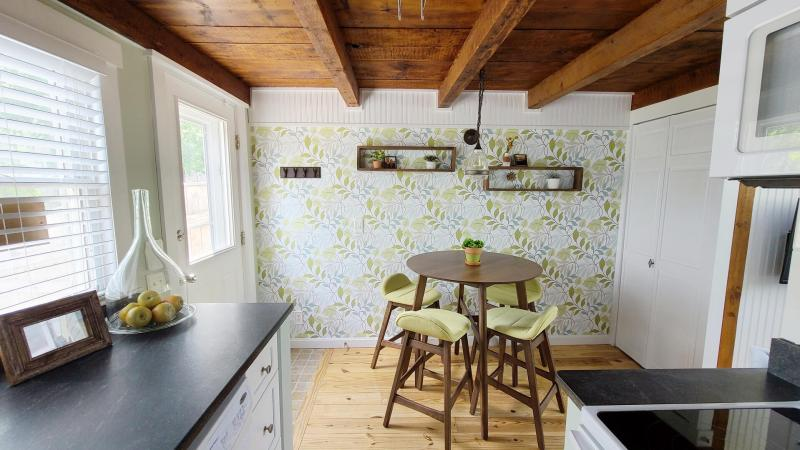 Kitchen opens to dining area by door to deck