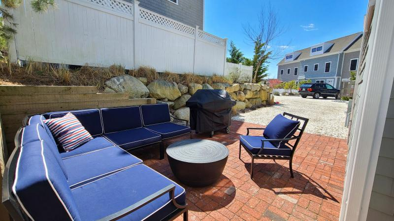 Comfortable outdoor space with seating and gas grill