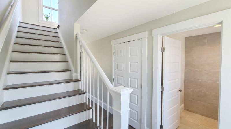 Stairs leading from second floor hall to third floor