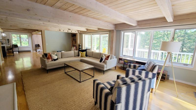 Living room with slider to screen porch