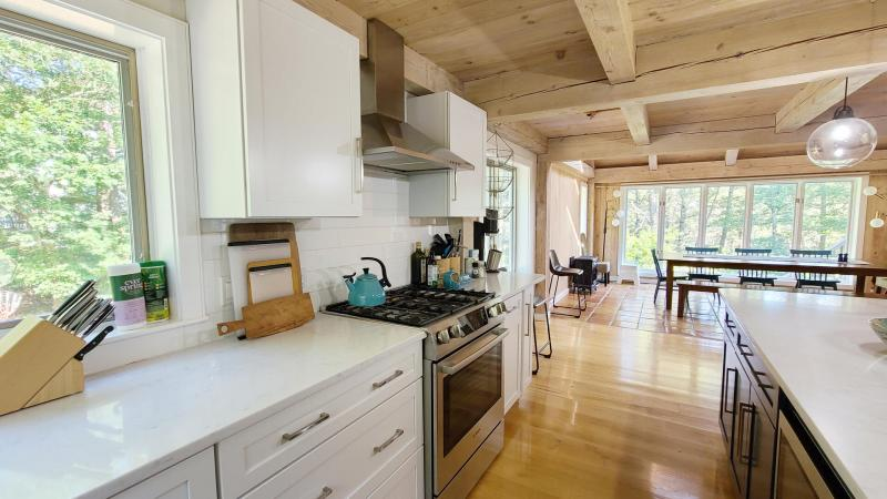 Bright kitchen is nicely equipped