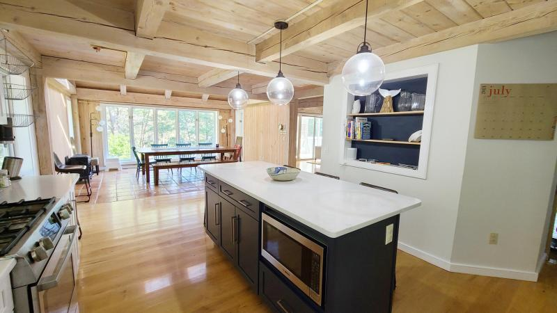 Kitchen has an island with counter seating