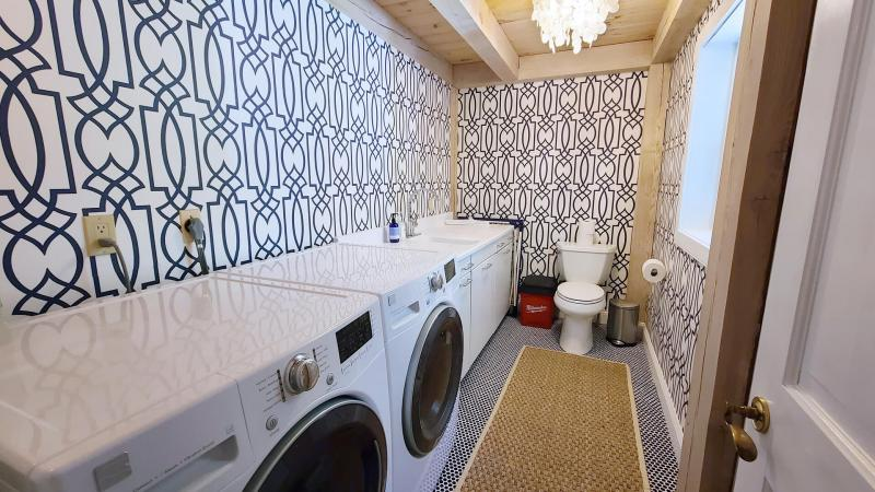 First floor half bath with washer and dryer