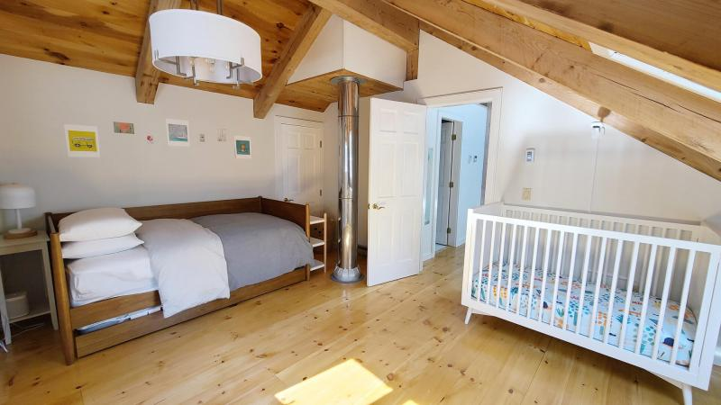 Second floor bedroom with twin with trundle and crib