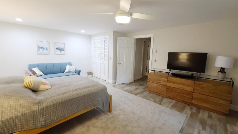Lower level bedroom with queen and slider