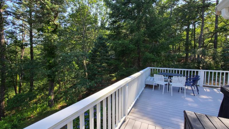 Deck with gas grill and outdoor furniture