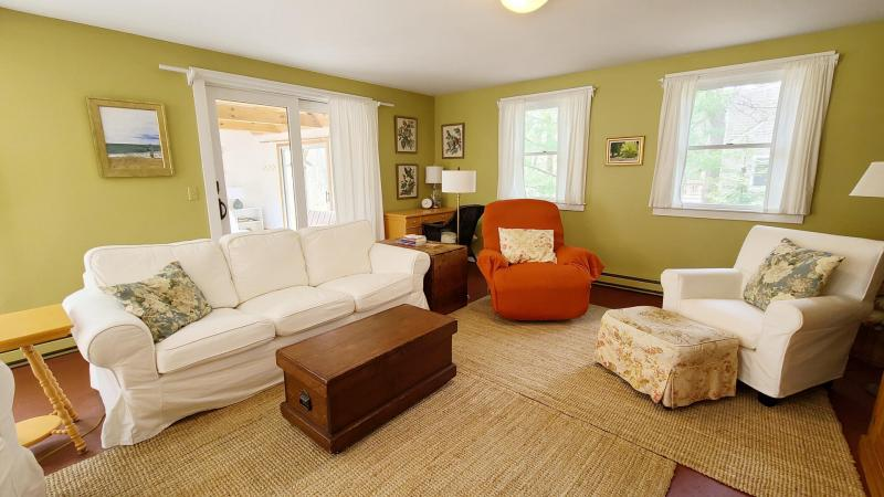 Living room has comfortable seating and a flat screen TV