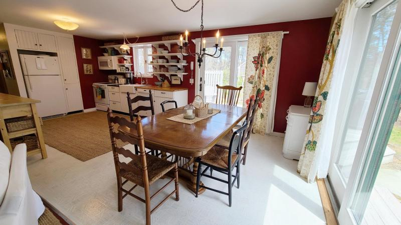 Dining table is just off kitchen